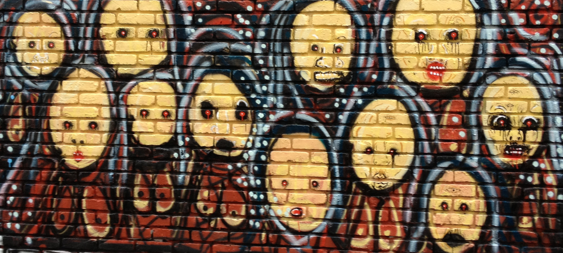photo of street art depicting the women of Troy.