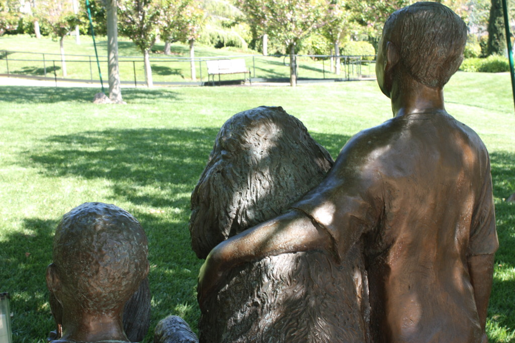 photo of bronze - kids with dog