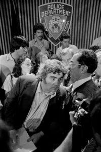 Mr. Breslin with Timothy J. Dowd, right, the police investigator who led the manhunt for the serial killer known as Son of Sam, at a news conference in August 1977 announcing the killer's capture. Credit Paul Hosefros/The New York Times